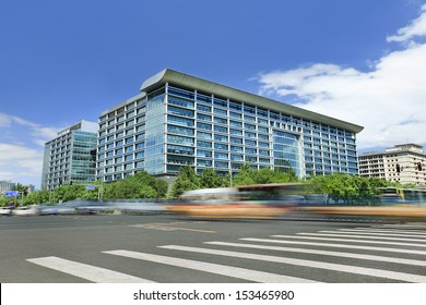 Modern office building with traffic in motion blur