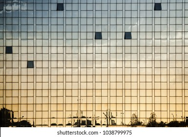Modern office building wall made of glass with open windows and reflections, abstract background photo texture