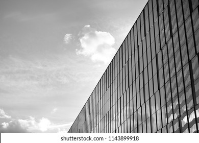 Modern office building wall made of steel and glass. Black and white.