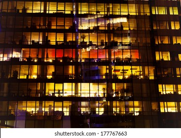 Modern office building windows at the night