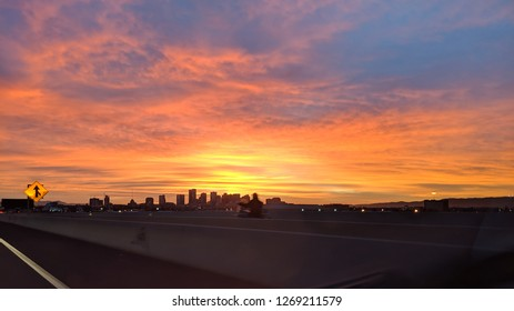 Modern office buildings back lit by red early morning sky in Phoenix downtown, Arizona