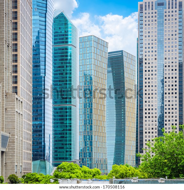 modern office buildings on sunny sky in shanghai financial center