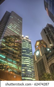Modern office buildings and skyscrapers exterior in night.