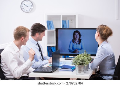Modern office - business team having web conference