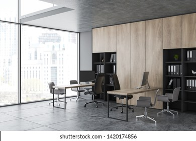 Modern office corner with gray walls, tile floor, panoramic window, wooden bookcase with folders and rows of computer desks with chairs for clients. 3d rendering