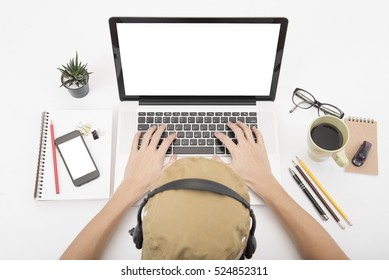 Modern Office desk with computer, notebook, headset, paper book and coffee cup.Top View table from above with copy space for input the text.