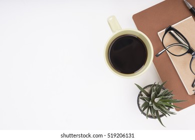 Modern Office desk with notebook, pen, paper book and coffee cup.Top View table from above with copy space for input the text.