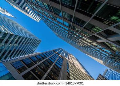 Modern office glasses buildings cityscape under blue clear sky in Washington DC, USA, outdoors financial skyscraper concept, symmetric and perspective architecture