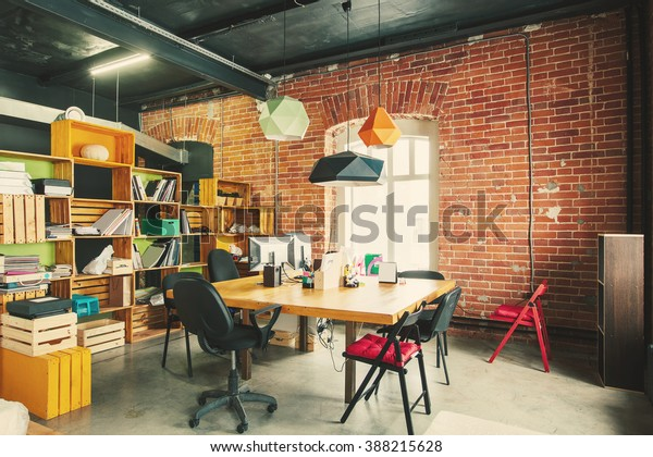 Modern office Interior with old vintage brick Wall. Art work business space