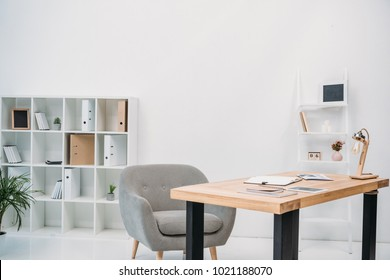 modern office interior with papers and digital tablet on table