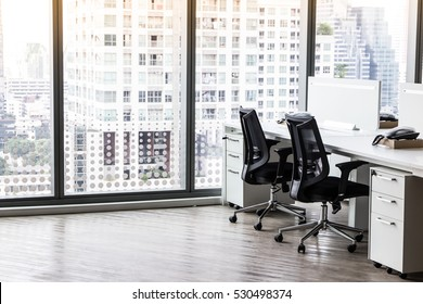 Modern office with open space to work thought the window and background city.