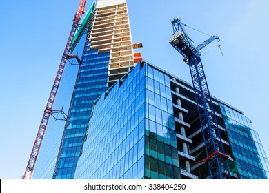 Modern office tower building construction with crane