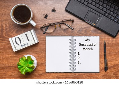 Modern office workplace with laptop keyboard, coffee cup, eyeglasses and plant. Date 01 March on wooden block calendar. Text MY SUCCESSFUL MARCH on white notepad page. Table desk top view, flat lay