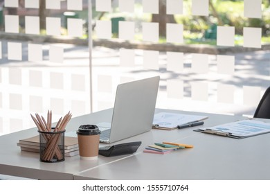 modern office workspace desk with laptop computer and office supplies. - business workplace concept