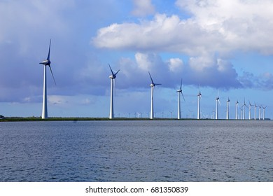 Modern Offshore Windmill Farm on a European River