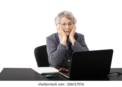 Modern old lady having emotional conversation by internet
