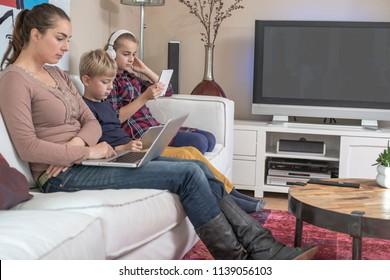 Modern online family all using internet.