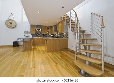 modern open plan kitchen in a designer apartment with mezzanine