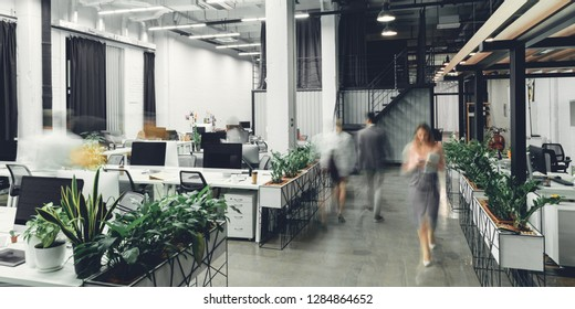 modern open space office interior with blurred business colleagues