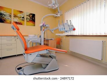 Modern orange dentist cabinet waiting for clients