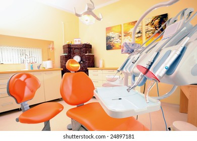Modern orange dentist chair waiting for clients