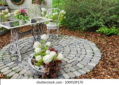 Modern Ornamental Decorative Backyard Patio Exterior With Iron Table, Chair And Many Flowerpots, Idea For Back Yard Design