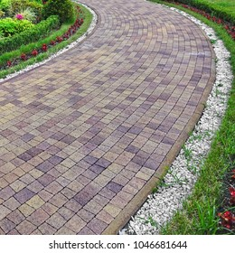 Modern Ornamental Garden Landscape With Tiled Colorful Mosaic Cobblestone Paving.  Marble White Gravel Along Walkway