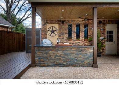Modern outdoor kitchen that has been freshly built - Shutterstock ID 1898835151