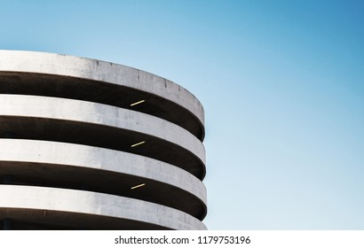 Modern parking lot building exterior, abstract fragment over blue sky background