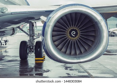 Modern passenger aircraft liner parked, view of the wing engine