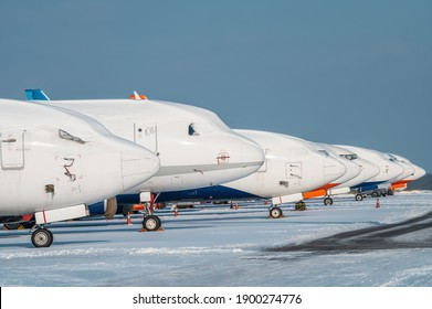 Modern passenger airplanes on the apron of airport. Airport in snow
