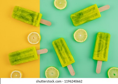 modern pastel background of lemon and lime Popsicle on yellow and green background