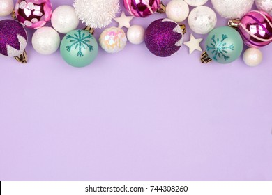 Modern pastel Christmas bauble top border over a light purple background