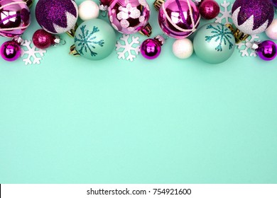 Modern pastel Christmas bauble top border over a  turquoise background