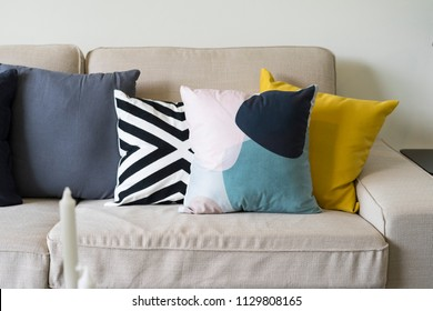 modern pattern and yellow cushion on grey sofa