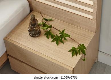 Modern peaceful Bedroom. zen style bedroom. Peaceful and serene bedroom. Wood bed with oriental object. japanese style bedroom.Deep sleep. meditation. Healing.side table.