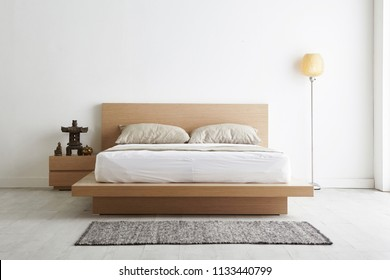 Modern peaceful Bedroom. zen style bedroom. Peaceful and serene bedroom. Wood bed with oriental object. japanese style bedroom.Deep sleep. meditation.