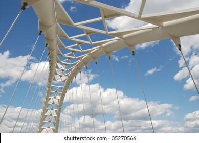 Modern pedestrian bridge against blue cloudy sky - Humber Bay Park in Toronto.