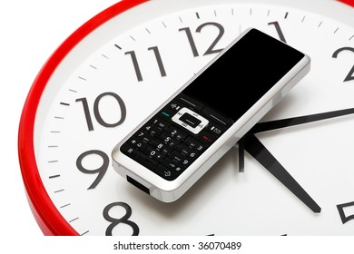 Modern phone on a dial of clock
