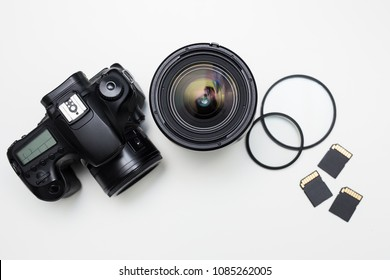modern photography equipment over white table background