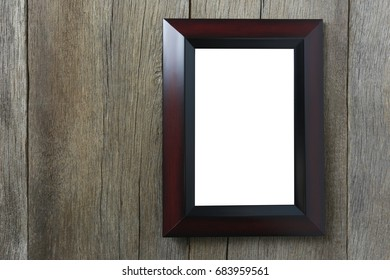 Modern Picture Frame on wooden wall and have copy space for design in your work.