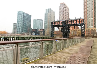 "Modern pier with ""Long Island"" painted on in Gantry Plaza State on foggy day, Queens, New York."