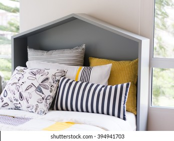 modern pillows on bed and modern headboard