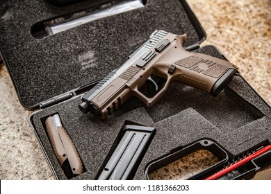 modern pistol on the table in case