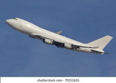 Modern Plane 747-400 on the blue sky background