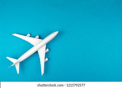 modern plane isolated on blue backdrop. Concept of aircraft industry