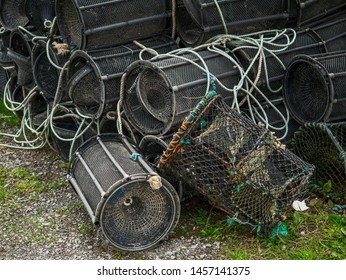 Modern plastic fish and crab traps ashore. Fishing industry.