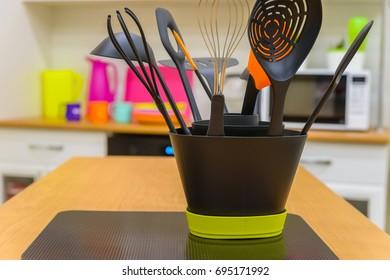 Modern plastic kitchen utensils in stand