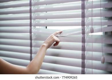 modern plastic shutter blinds with hand
