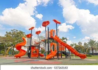 Modern playground equipment on yard in the park.